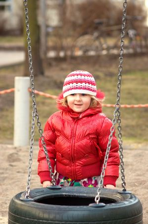 A photo of 4 years old girl playing on playground
