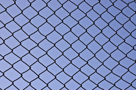 A photo of wired fence in fron of blue sky Stock Photo - 4651766