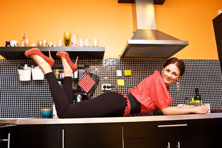 Attractive woman posing in modern kitchen