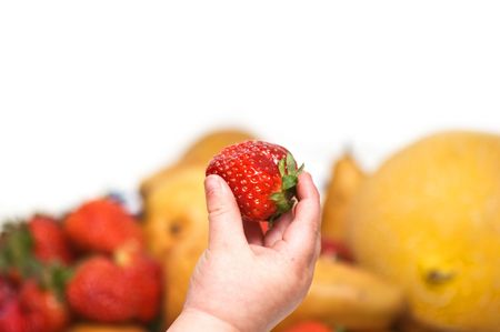 Baby's hand holding strawberry Stock Photo - 4885081