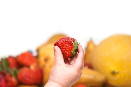 Baby's hand holding strawberry Stock Photo - 4885081