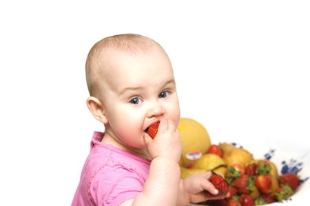 Baby eating strawberry photo