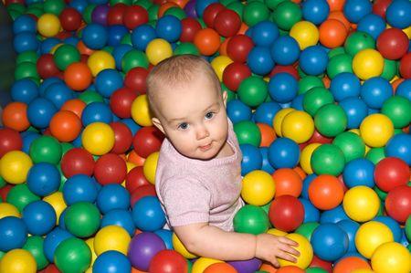 playcentre: Baby girl on ball playground