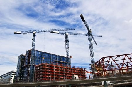 Building cranes in action in Stockholm photo