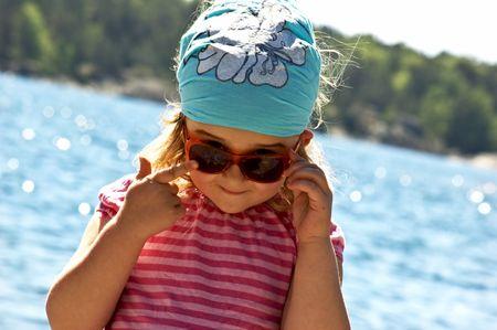 4 years old girl near the sea Stock Photo - 5089403