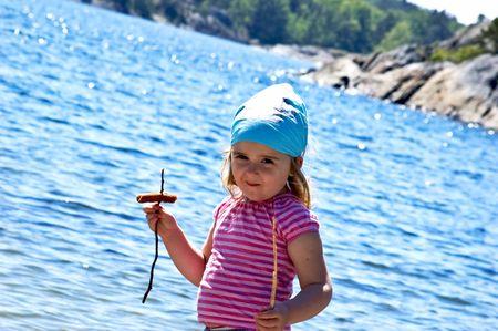 4 years old girl near the sea