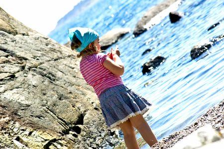 4 years old girl near the sea photo
