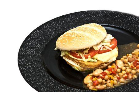 Chicken burger with bean sallad photo