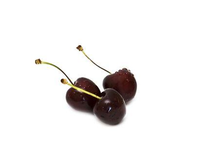 Fresh sweet cherries on white