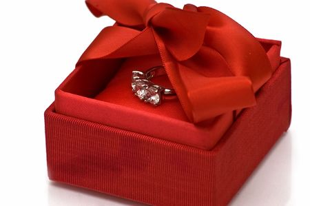 Red gift box with platinum ring photo