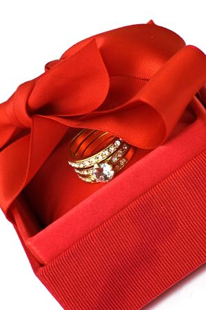 Red gift box with golden ring photo