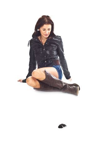 Brunette girl in jeans and boots