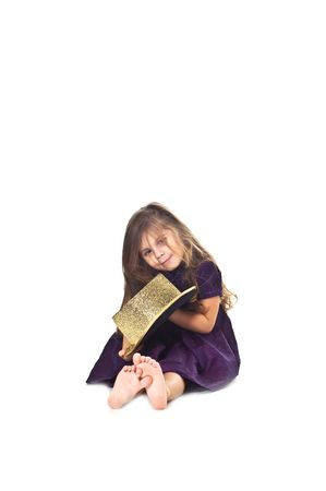 Little girl holding golden cylinder hat