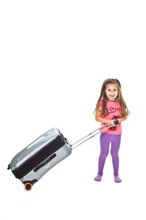 Little girl with travel bag Stock Photo