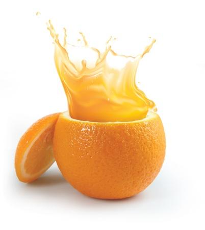 Orange juice splashing isolated on white