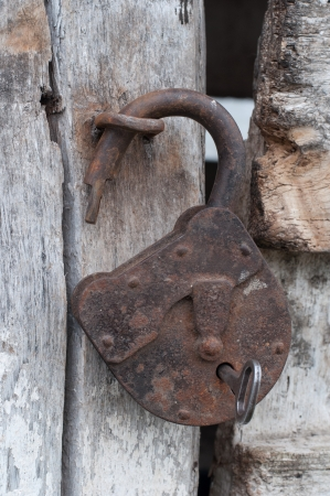 Old open padlock and key photo