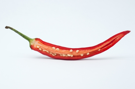 Chili pepper sliced on a white photo