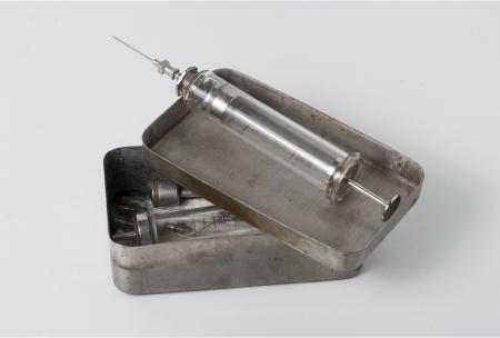Old syringe with opened sterilizing box