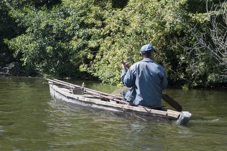 fisherman boat: Fisherman fishing on a boat