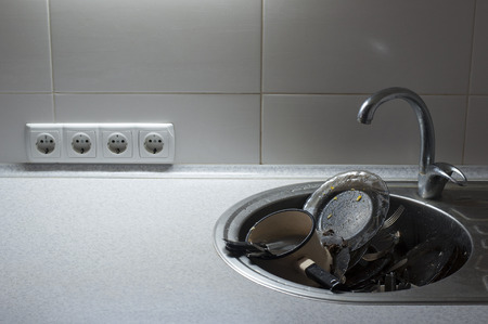 messy kitchen: Kitchen with piles of dirty dishes