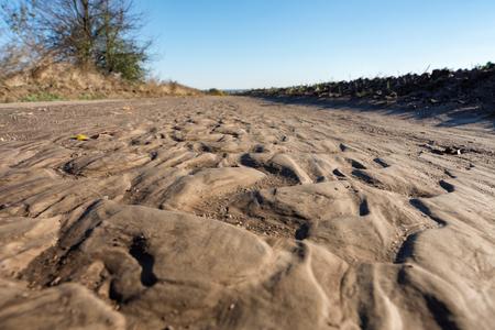 slump: Broken rural road with deep water tracks