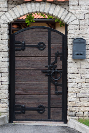 Wooden door with metal decoration.