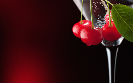 Cherries in a martini glass. 스톡 콘텐츠