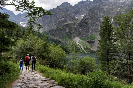 Young family exploring road in the mountain. Tatra National Park, Poland. 스톡 콘텐츠