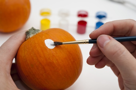 decorating: Decorating pumpkins for Halloween with paint