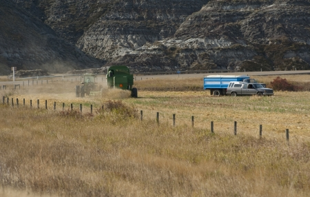 Combine harvesting grain in the fall on the prairies photo