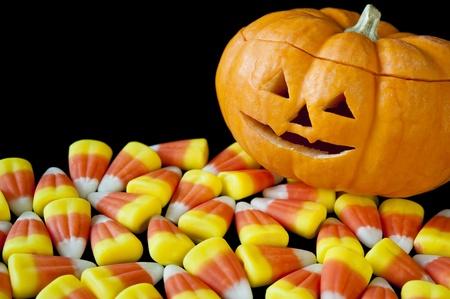 Smiling jack-o-lantern with candy corn Stock Photo