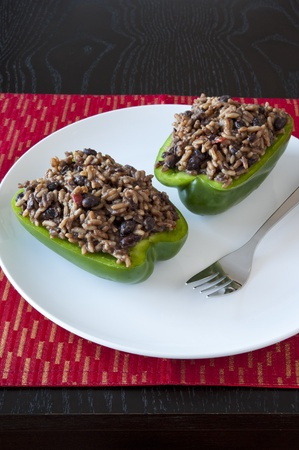 Two green peppers stuffed with rice and black beans Stock Photo