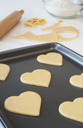 Heart shaped cookies on a pan ready to be cooked