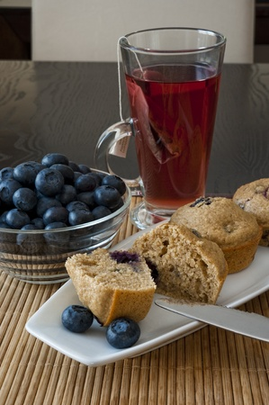 Blueberry muffin breakfast with blueberries and tea