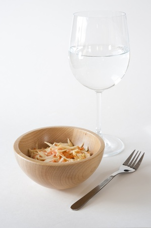 Coleslaw Salad with water glass isolated on white