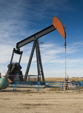 Oil pumpjack on a prairie landscape Stock Photo - 9666259