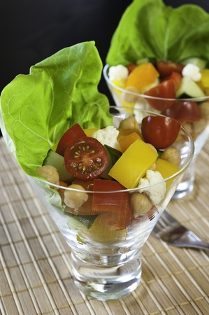 garbanzo bean: Two dishes of colorful chickpea and vegetable salad Stock Photo