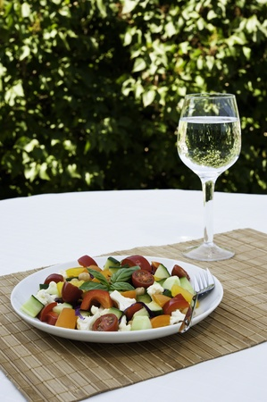 garbanzo bean: Plate of colorful chickpea and vegetable salad with a glass of water