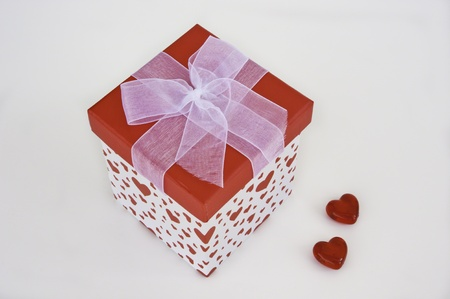 Heart gift box with a red lid and white bow with glass hearts Stock Photo