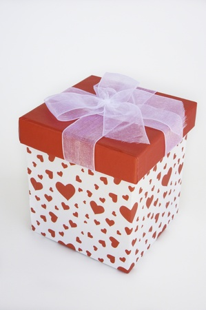 Heart gift box with a red lid and white bow