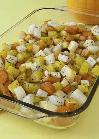 Pan of colorful root vegetables roasted with rosemary and thyme