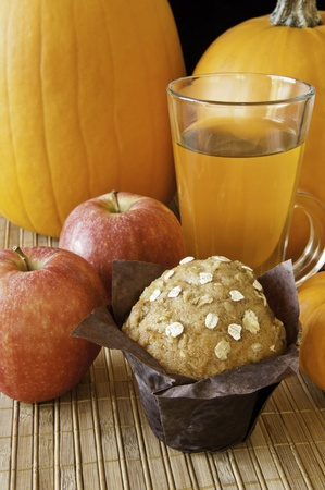 oatmeal: Oatmeal apple muffin, apples and tea with pumpkins Stock Photo