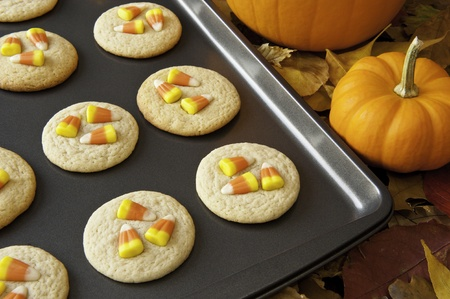 Pan of cookies decorated with candy corns for Halloween