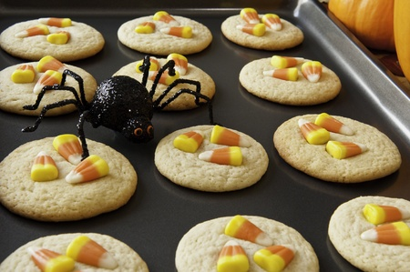 Pan of candy corn cookies with a black spider photo