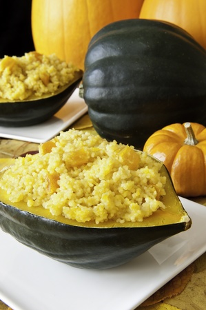 Stuffed acorn squash with pumpkins Stock Photo