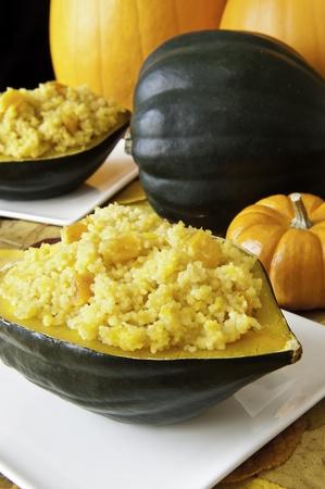 Stuffed acorn squash with pumpkins Stock Photo