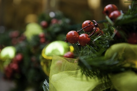 Holiday berries with baubles, ribbon and pine  boughs