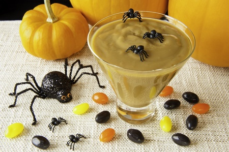 Butterscotch pudding with Halloween spiders and jellybeans