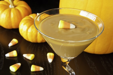 Butterscotch pudding with candy  corns and pumpkins Stock Photo