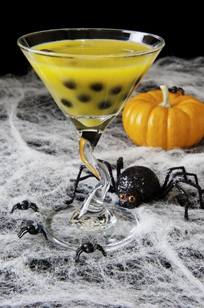 Halloween bubble tea with cobwebs, spiders and pumpkins photo